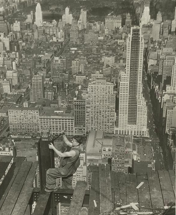A worker tightens a bolt on a column during the construction of the Empire State Building.
