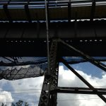 A debris net supsended under a bridge protects workers from falling debris.