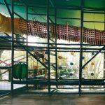 A cargo climbing net tunnel in a children's museum.