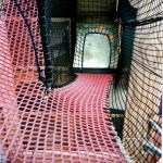Climbing nets can lead in many directions, allowing people to move from one level to another in tight spaces.
