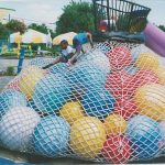Giant balls in a climbing net bag.