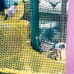 children climbing up a spiral net ramp
