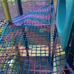 Purple and blue climb netting.