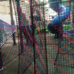 Colorful barrier netting in a maze.