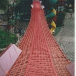A red rope net bridge.
