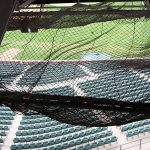 Safety netting for sports stadiums.
